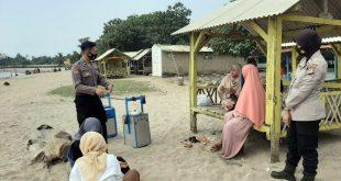Polda Banten Disiplinkan Masyarakat Di Wisata Pantai, Terapkan Protokol Kesehatan